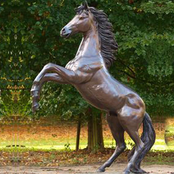 Outside life size antique bronze statues of rearing horse standing on two legs